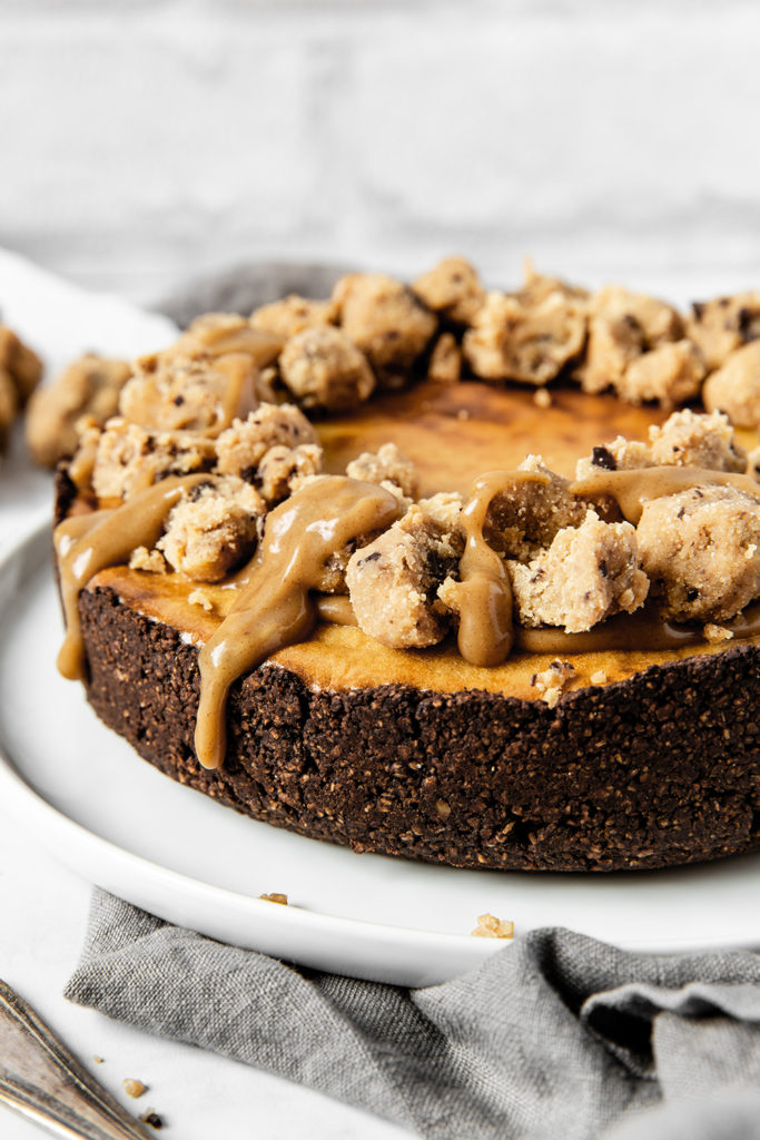 Vegan baked cookie dough cheesecake with salted caramel
