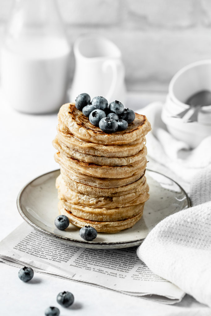 Stack of fluffy vegan sourdough pancakes with berries
